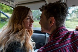 Portrait of young couple in car, looking passionately at each other, Sussex, South East England, England, United Kingdom